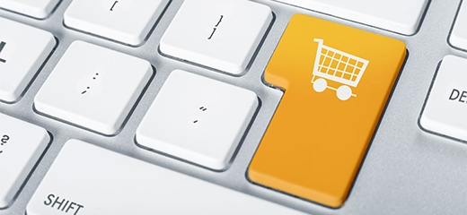 Egy billentyűzet részlet, enter helyett bevásárlókosár mintás gomb.